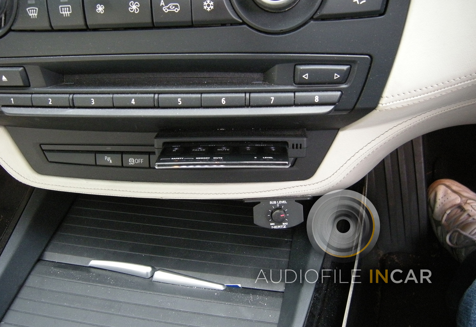 This shows a Stinger GPS Card custom fitted to a BMW X5,  The holder has been moulded into the dash panel and finished in the exact paint to match the interior.