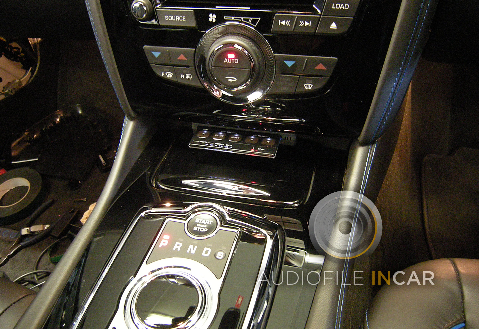 Another example of a Stinger GPS Card installation, this time it sits neatly at the base of the dash in a Jaguar XK RS, This car was also fitted with no less than three separate laser analyser / diffusers for driver safety and peace of mind.