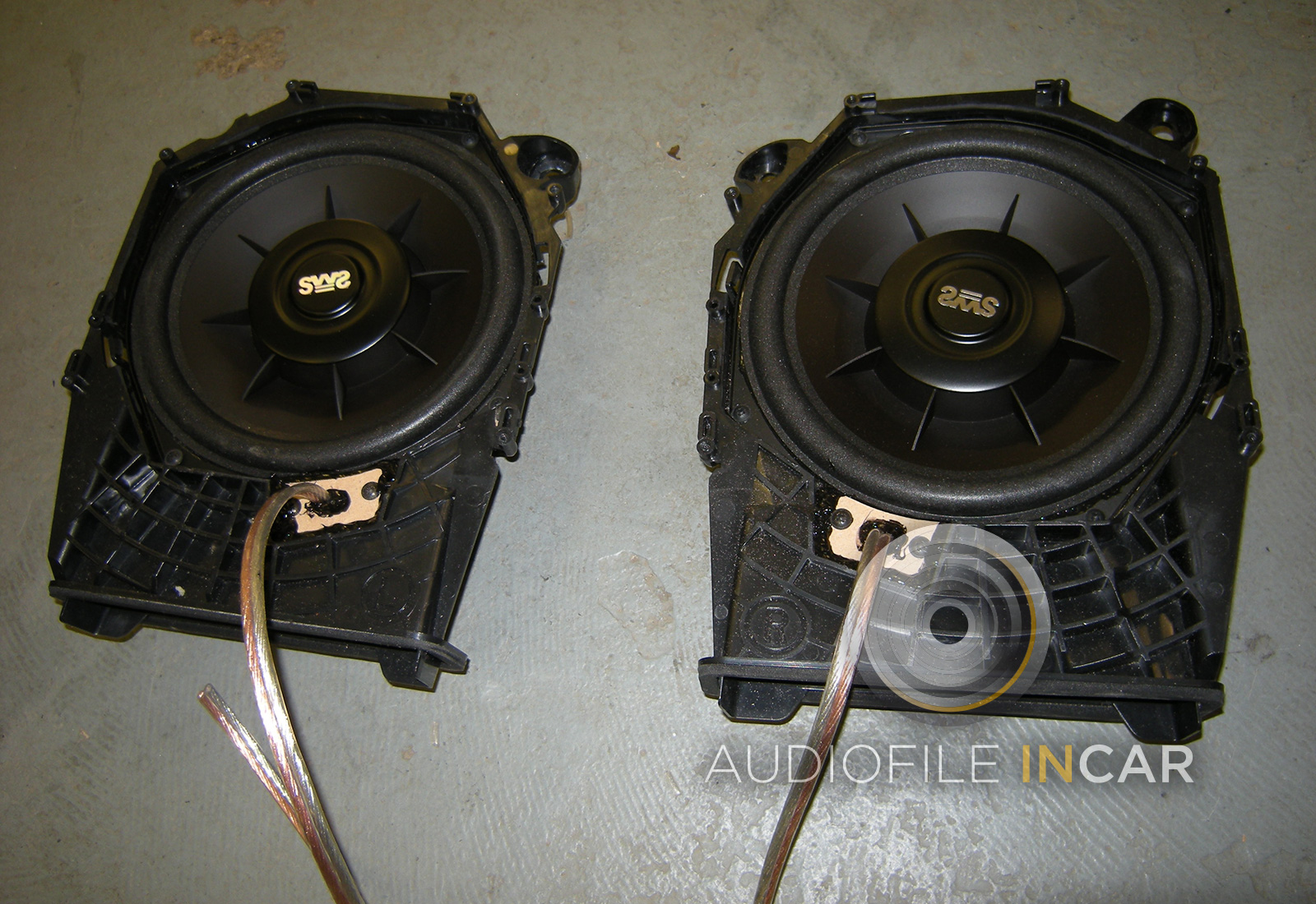 This shows the BMW enclosures removed and modified with the upgraded Earthquake SWS subwoofers fitted