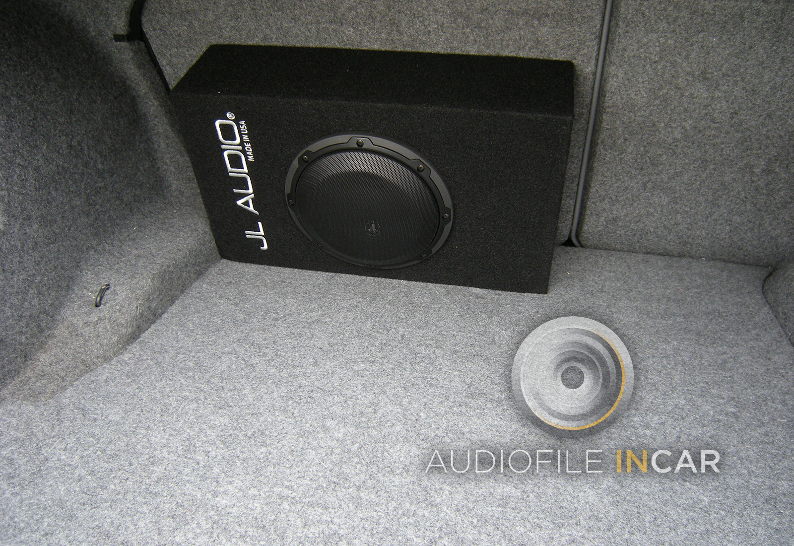 "JL Audio 8"" compact subwoofer mounted in E46 boot, good bass output without losing too much load space."