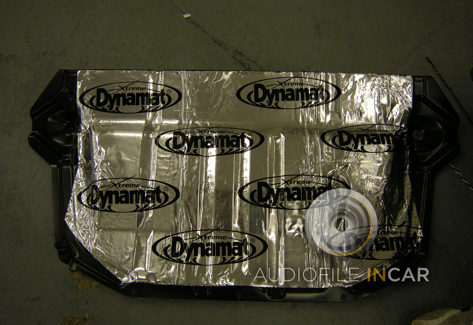 Metal fuel tank cover also covered in Dynamat to stop vibration.