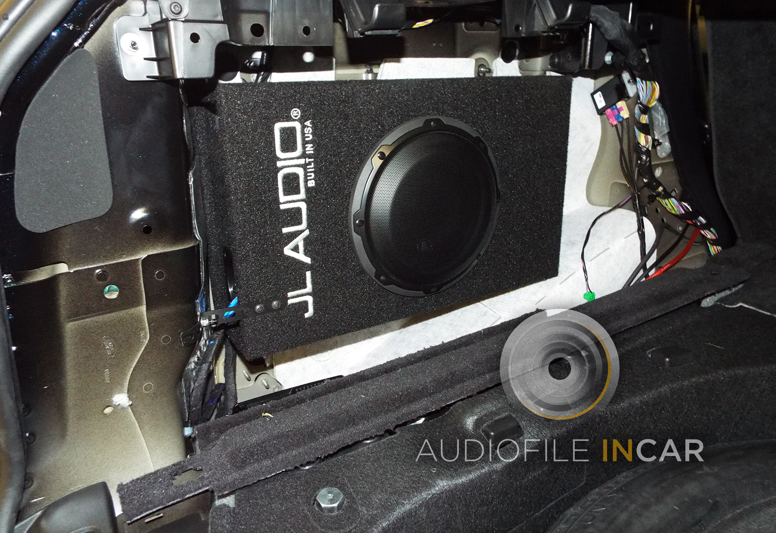 This image shows the JL Audio Compact Subwoofer mounted in the boot before the trim panels are refitted. Soundproofing is applied behind the subwoofer to kill any resonance or vibration. This subwoofer works incredibly well.