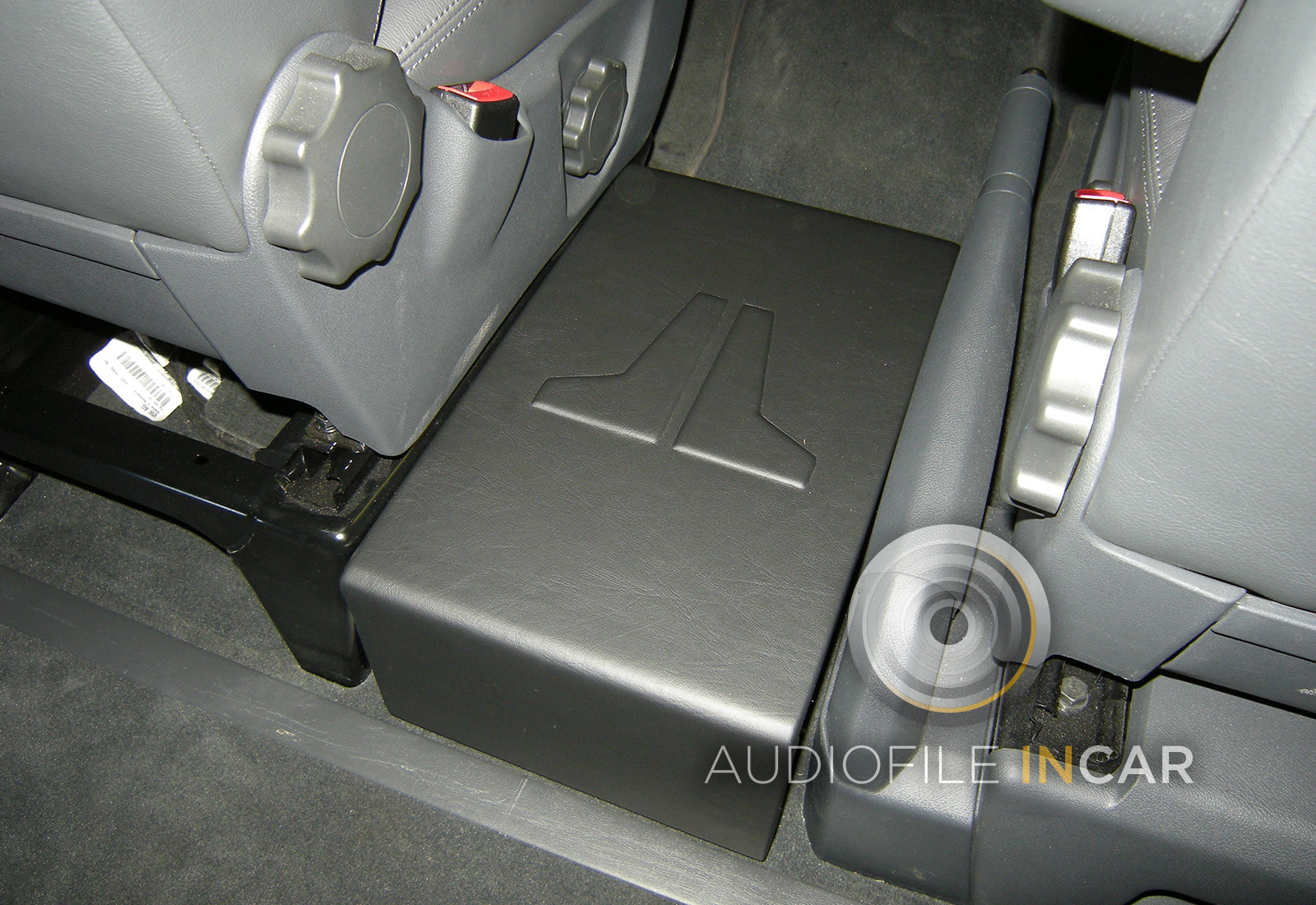 The Sub-Bass is provided by a down-firing JL Audio 6W3 subwoofer, we then fabricate a custom top panel with the JL logo inset to make the installation unique.